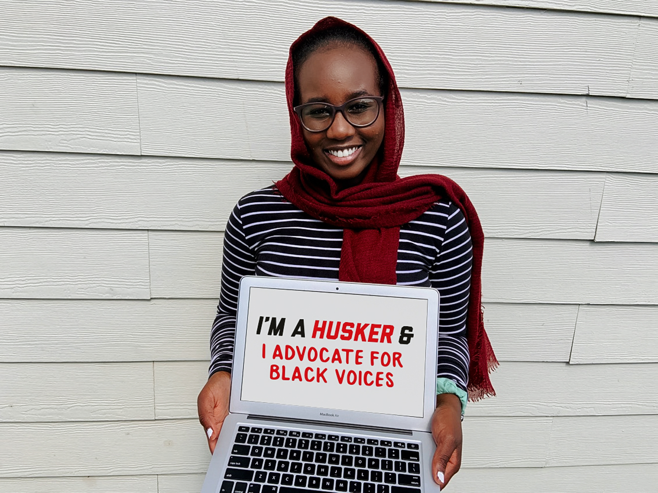 """Aiah holding a sign that says """"I'm a Husker and I advocate for Black voices."""""""