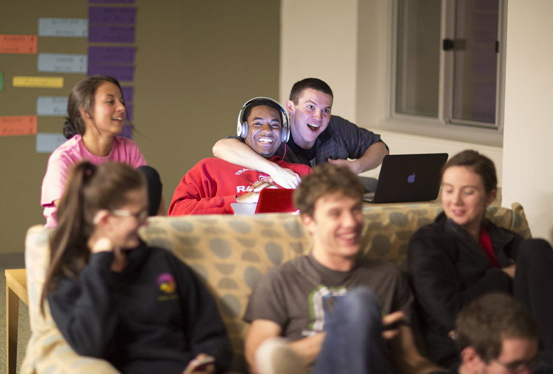students relaxing in residence hall