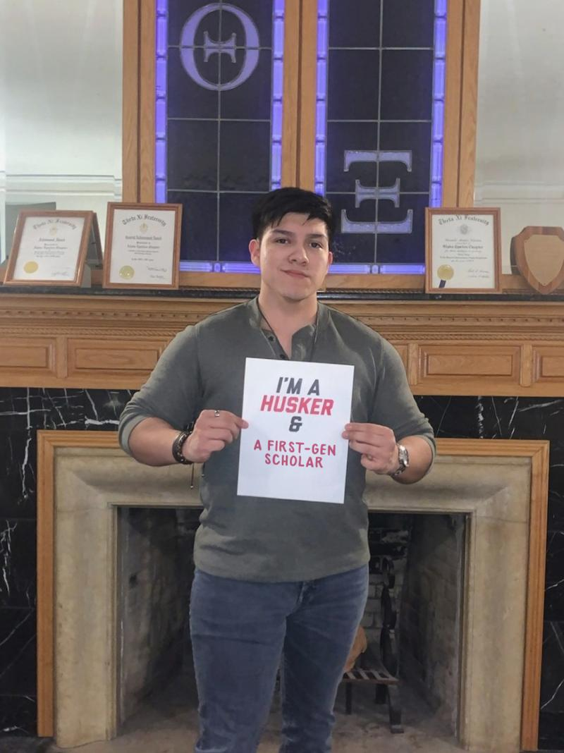 """Antonio holds a sign that says """"I'm a Husker & a first-gen scholar"""""""