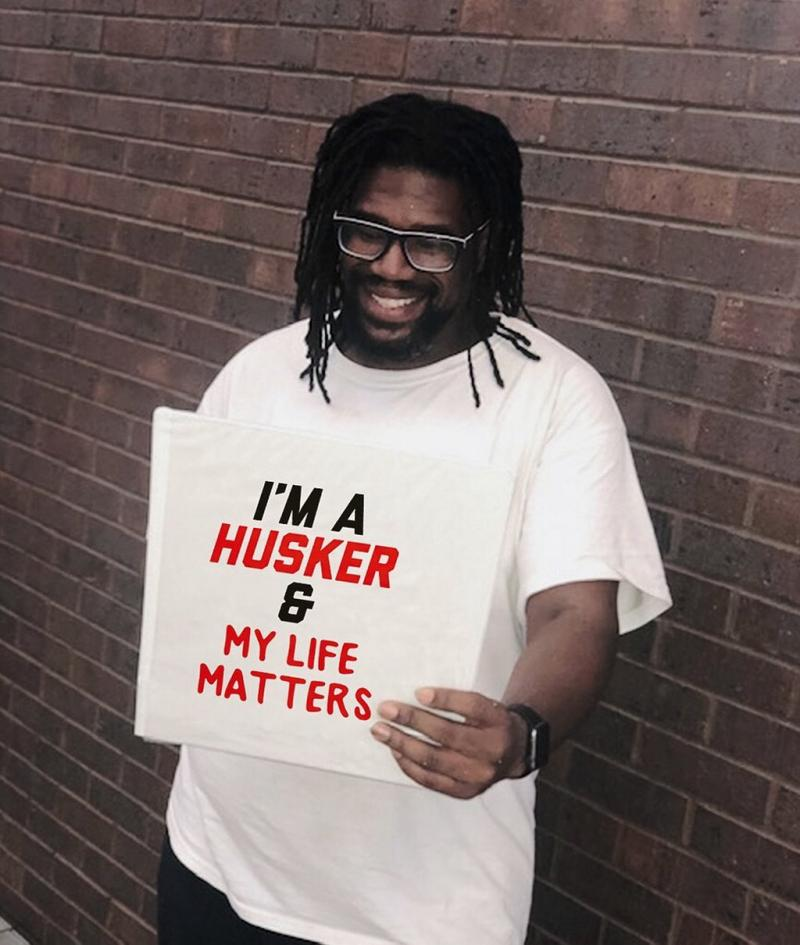 """Kevin holding a sign that says """"I'm a Husker and My Life Matter."""""""