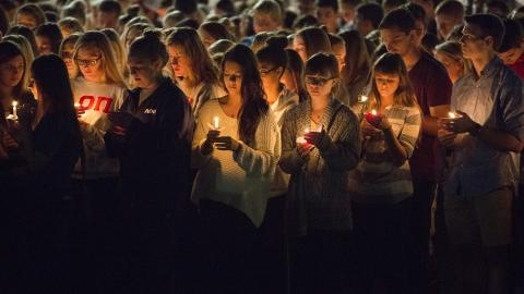 Photo of candelight vigil on campus