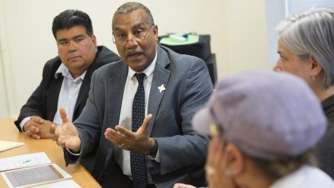 Joseph Francisco (center), dean of Arts and Sciences, discusses the new policy with ethnic studies faculty on April 20.