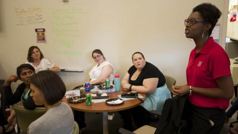 "Mecca Slaughter (right), a UNL admissions employee, speaks during a ""Dish It Up"" conversation July 15 at the Jackie Gaughan Multicultural Center."