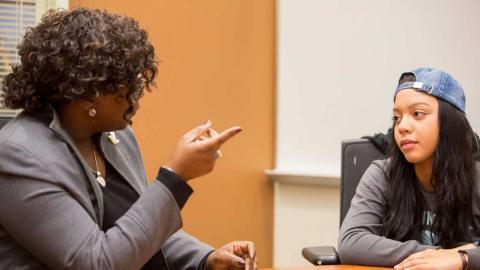 Charlie Foster and Peyton Bishop talk at a Sister Circle meeting