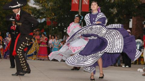 Photo of dancers performing at a past Fiesta on the Green event