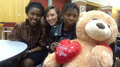 Grace Abraham with friends and teddy bear