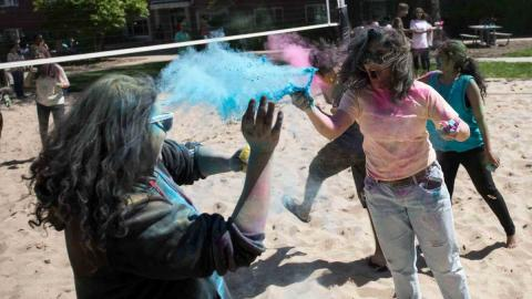Students spray colored powders during Holi festival ad the University of Nebraska-Lincoln.