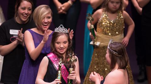 Maddie Lorenzen crowns a queen at the Iowa Miss Amazing Pageant
