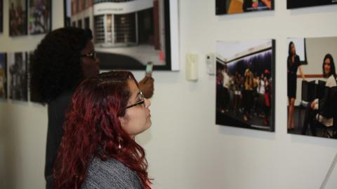 A student admires new photos in the Mandala Lounge.