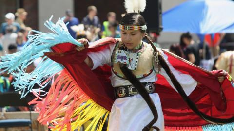 Native American dancer performs on the Nebraska Union green space.