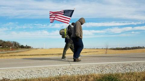 Courtesy photo - Volunteers on team Nebraska walk a stretch of highway as part of the veteran suicide awareness ruck march to Iowa City.