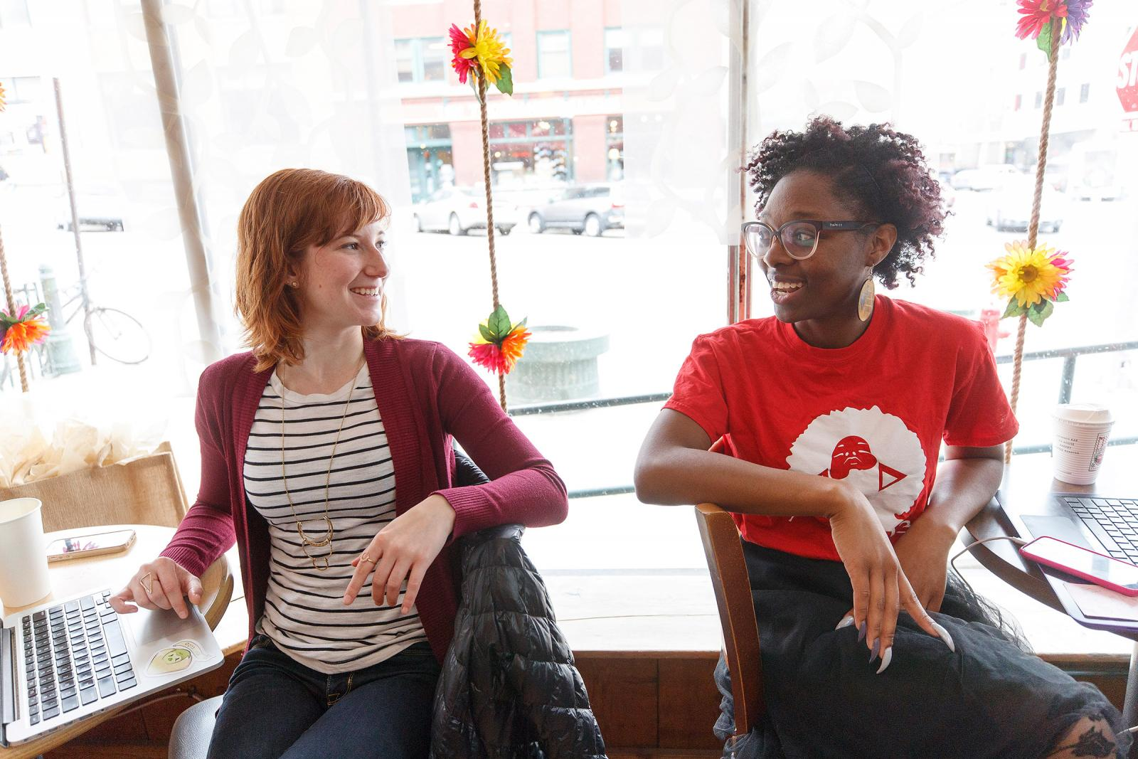 Two students sitting at coffee shop